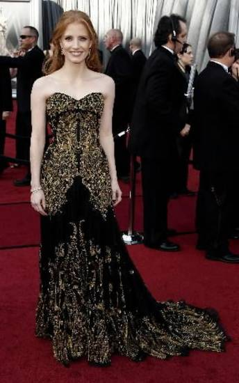 Jessica Chastain arrives before the 84th Academy Awards on Sunday, Feb. 26, 2012, in the Hollywood section of Los Angeles. (AP)