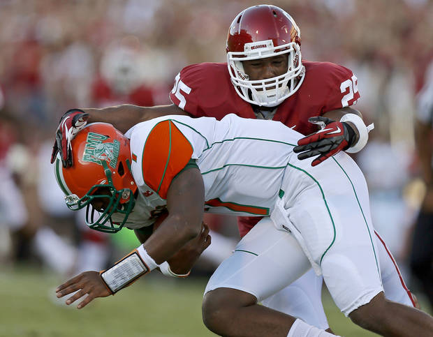 Oklahoma's Aaron Franklin (25) brings down Florida A&M's Damien Fleming (7) during the college football game between the University of Oklahoma Sooners (OU) and Florida A&M Rattlers at Gaylord Family�Oklahoma Memorial Stadium in Norman, Okla., Saturday, Sept. 8, 2012. Photo by Bryan Terry, The Oklahoman