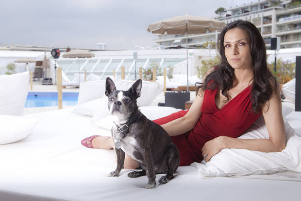 "Famke Janssen is shown May 2011 as she promotes the film ""Bringing Up Bobby"" at the 64th international film festival in Cannes, southern France. The film, shot in and around Oklahoma City, will Screen Saturday at the deadCenter Film Festival in Oklahoma City. AP PHOTO <strong></strong>"