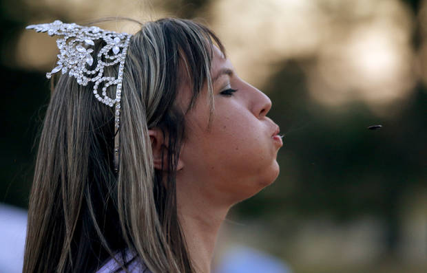 Sixteen-year-old 2012 Rush Springs Watermelon Queen May'zey Brown competes in a watermelon seed-spitting competition after a free 5k run in Stars and Stripes Park at Lake Hefner in Oklahoma City on Wednesday, July 18, 2012. The run was held to promote the upcoming Rush Springs Watermelon Festival. Photo by Bryan Terry, The Oklahoman