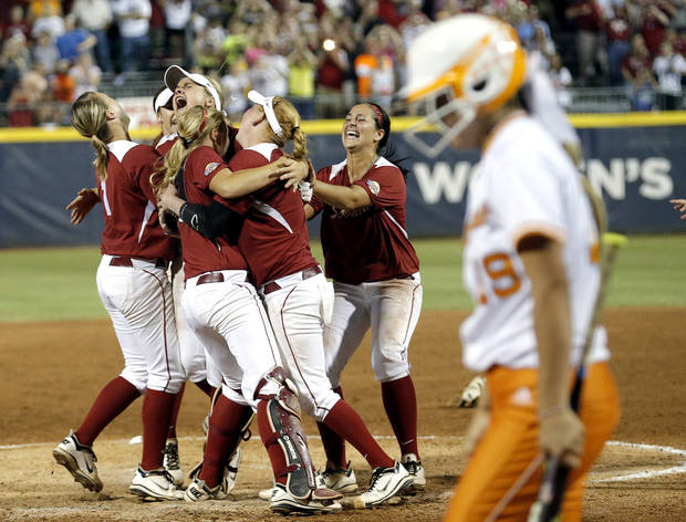 Tennessee's Lexi Overstreet (19) walks off the field as Oklahoma celebrates their championship during Women's College World Series softball game between Oklahoma and Tennessee at ASA Hall of Fame Stadium in Oklahoma City,Tuesday, June, 4, 2013. Photo by Sarah Phipps, The Oklahoman