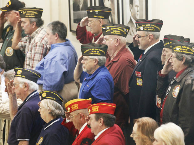 Veterans salute during the pledge of allegiance during a joint session of Legislature to honor veterans at the state Capitol, Wednesday, February 22, 2012.   Photo by David McDaniel, The Oklahoman