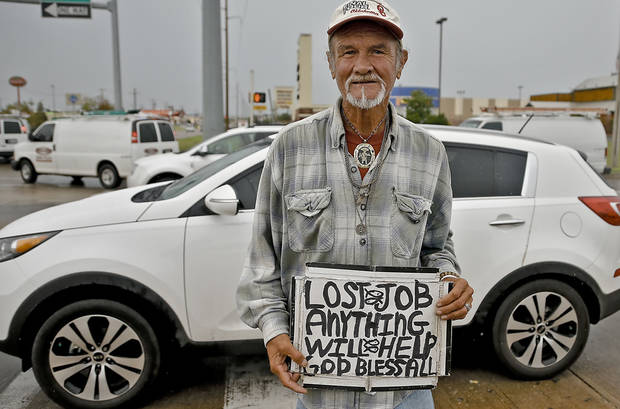 Ralph, 58, of Santa Monica, Calif., panhandles Thursday  at Pennsylvania Avenue and  Memorial Road in Oklahoma City. Ralph did not wish to give The Oklahoman his last name for publication  Photo by  Chris Landsberger,  The Oklahoman