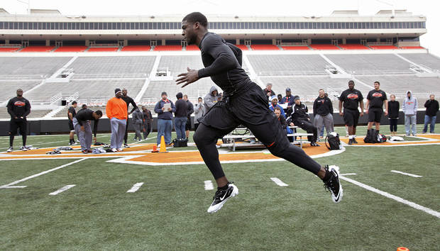 Andrew McGee runs the shuttle drill fro scouts during the NFL pro day at Oklahoma State University on Wednesday, March 9, 2011, in Stillwater, Okla.  Photo by Chris Landsberger, The Oklahoman