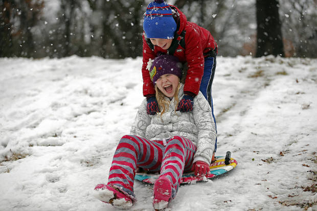 Turner and Ryan, front, Kinzer sled at Hafer Park in Edmond, Okla., Tuesday, Feb. 13, 2013.Photo by Sarah Phipps, The Oklahoman