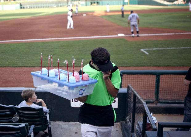 Bryant Preston sells snow cones during the minor league baseball game between the Oklahoma City RedHawks and the Omaha Storm Chasers at RedHawks Field at Bricktown, Saturday, July 9, 2011. Photo by Sarah Phipps, The Oklahoman
