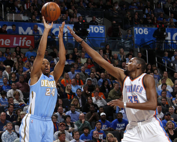 Denver's Andre Miller (24) shoots a basket beside Oklahoma City's Kevin Durant (35) during an NBA basketball game between the Oklahoma City Thunder and the Denver Nuggets at Chesapeake Energy Arena in Oklahoma City, Tuesday, March 19, 2013.Denver won 114-104. Photo by Bryan Terry, The Oklahoman