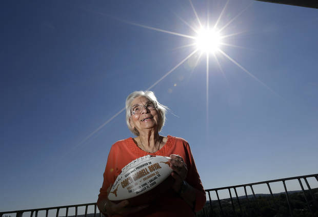 Edith Royal, wife of former Texas football coach Darrell K. Royal, poses for a photo at her home, Tuesday, Oct. 30, 2012, in Austin, Texas. The Royals are auctioning off Longhorn memorabilia to raise funds for Alzheimer's research. (AP Photo/Eric Gay)
