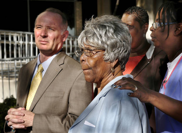 Robin Howard�s mother, Lonzetta Morrison, stands beside attorney David Slane on Thursday at the Oklahoma City Police Department headquarters.  Photo by Jim Beckel, The Oklahoman