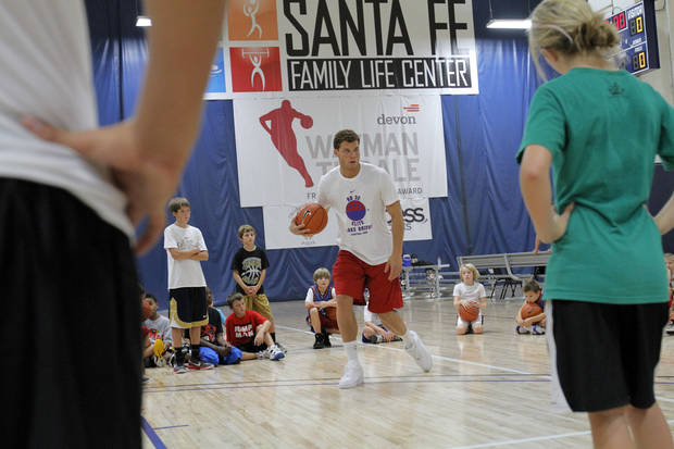 Blake Griffin gives a demonstration on drills during the Blake Griffin basketball camp at the Santa Fe Family Life Center in Oklahoma City Thursday, Aug. 4, 2011.  Photo by Garett Fisbeck, The Oklahoman