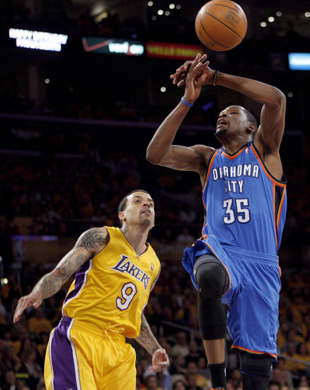 Oklahoma City's Kevin Durant (35) loses the ball as Los Angeles' Matt Barnes (9) looks on during Game 3 in the second round of the NBA basketball playoffs between the L.A. Lakers and the Oklahoma City Thunder at the Staples Center in Los Angeles, Friday, May 18, 2012. Photo by Nate Billings, The Oklahoman