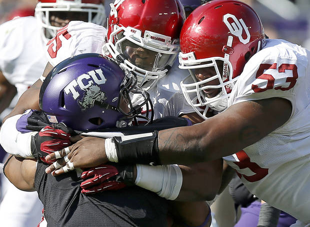 tou85nd/ and Casey Walker (53) bring down TCU&#039;s Trevone Boykin (2) during a college football game between the University of Oklahoma Sooners (OU) and the Texas Christian University Horned Frogs (TCU) at Amon G. Carter Stadium in Fort Worth, Texas, Saturday, Dec. 1, 2012. Oklahoma won 24-17. Photo by Bryan Terry, The Oklahoman