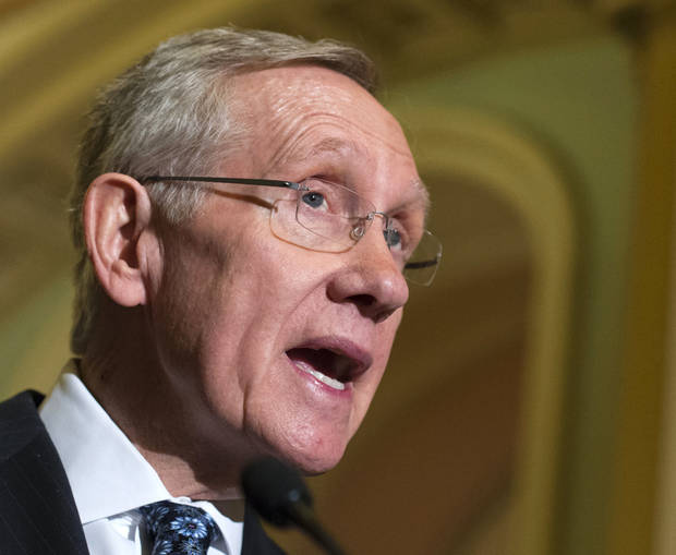 FILE - In this Feb. 26, 2013 file photo, Senate Majority Leader Harry Reid of Nev. speaks on Capitol Hill in Washington. President Barack Obama will meet Friday with the top leaders in the House and Senate to discuss what to do about automatic cuts to the federal budget, White House and congressional leaders said. The meeting is set to take place hours after the $85 billion in across-the-board cuts will have officially kicked in. This suggests both sides are operating under the assumption a deal won't be reached to avert the cuts ahead of the March 1 deadline.  (AP Photo/J. Scott Applewhite, File)