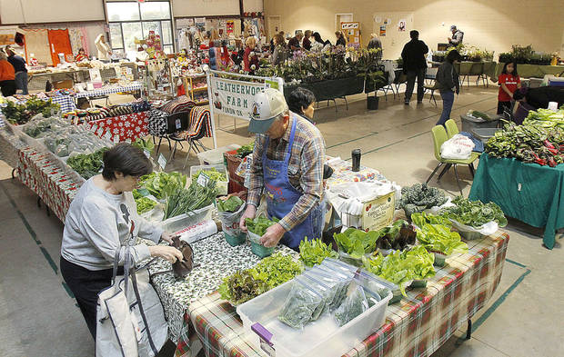 Buyers look through fresh vegetables Saturday as OSU-OKC hosts several free events on its campus in Oklahoma City during its weekly Farmers Market.  Photos by Paul Hellstern, The Oklahoman
