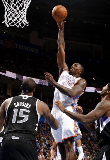 Oklahoma City's Kendrick Perkins (5) shoots the ball over Sacramento's DeMarcus Cousins (15)  during an NBA basketball game between the Oklahoma City Thunder and the Sacramento Kings at Chesapeake Energy Arena in Oklahoma City, Friday, Dec. 14, 2012. Photo by Bryan Terry, The Oklahoman