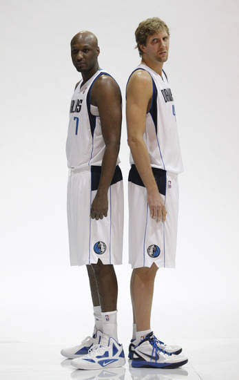 Dallas Mavericks' Lamar Odom (7) and Dirk Nowitzki (41) of Germany, pose for a photo during  NBA basketball media day in Dallas,  Tuesday, Dec. 13, 2011. (AP Photo/LM Otero)