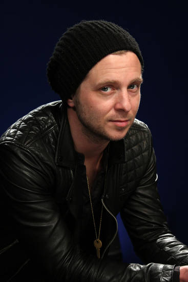 "This Feb. 27, 2013 photo shows OneRepublic frontman Ryan Tedder in New York. OneRepublic's third album, ""Native,"" was released on March 26. (AP Photo/John Carucci) ORG XMIT: NYET480"