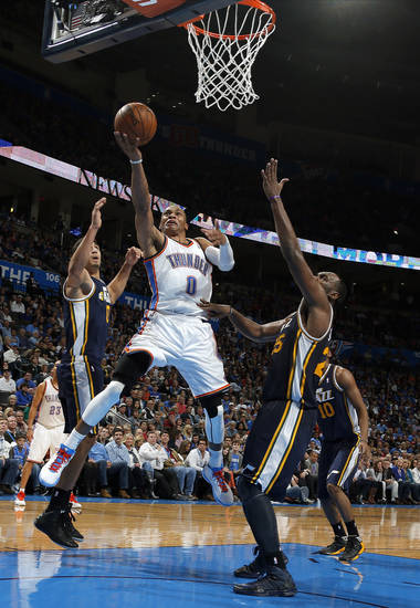 Oklahoma City's Russell Westbrook (0) shoots in between Utah's Enes Kanter (0) and Utah's Al Jefferson (25) during the NBA game between the Oklahoma City and the Utah Jazz and the Chesapeake Energy Arena, Friday,Nov. 30, 2012. Photo by Sarah Phipps, The Oklahomane