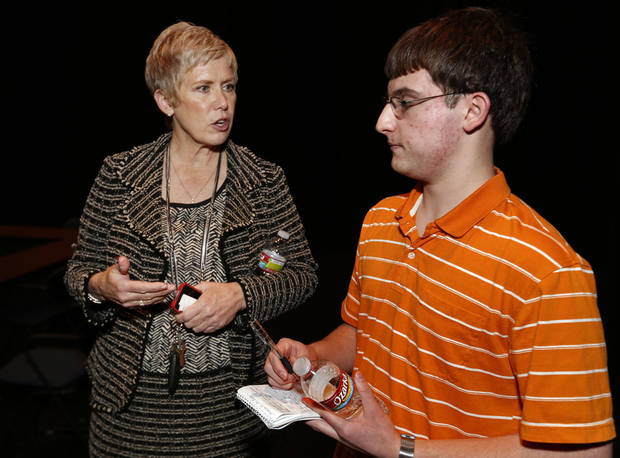 State schools Superintendent Janet Baressi talks with high school student Kenneth McCann prior to a community forum held in conjunction with a tour of the Norman School District. PHOTO BY STEVE SISNEY, THE OKLAHOMAN <strong>STEVE SISNEY</strong>