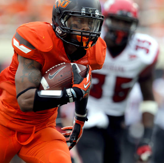 Oklahoma State's Josh Stewart (5) runs in for a touchdown as Louisiana-Lafayette's Boris Anyama (35) chases him down during a college football game between Oklahoma State University (OSU) and the University of Louisiana-Lafayette (ULL) at Boone Pickens Stadium in Stillwater, Okla., Saturday, Sept. 15, 2012. Photo by Sarah Phipps, The Oklahoman
