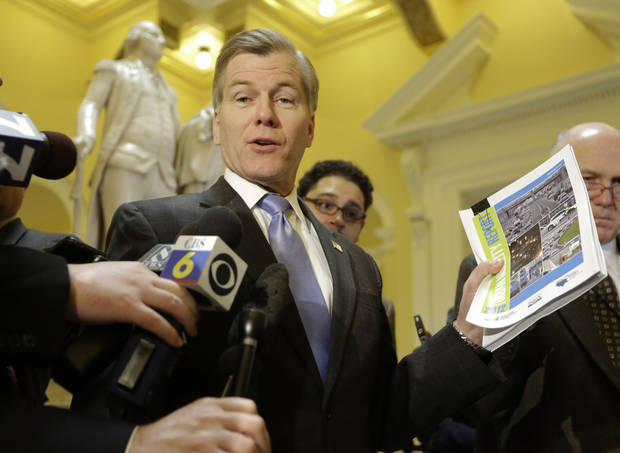 Virginia Gov. Bob McDonnell displays a report on highway congestion as he speaks to the press in front of a statue of George Washington at the Capitol Tuesday, Feb.  5, 2013 in Richmond, Va.  McDonnell called for a yes vote on his transportation bill.  The House approved the legislation.  (AP Photo/Steve Helber)