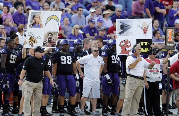 Coaches signal defenses with cards during the second half of the college football game where the University of Oklahoma Sooners (OU) defeated the Texas Christian University Horned Frogs (TCU) 24-17 at Amon G. Carter Stadium in Fort Worth, Texas, on Saturday, Dec. 1, 2012. Photo by Steve Sisney, The Oklahoman