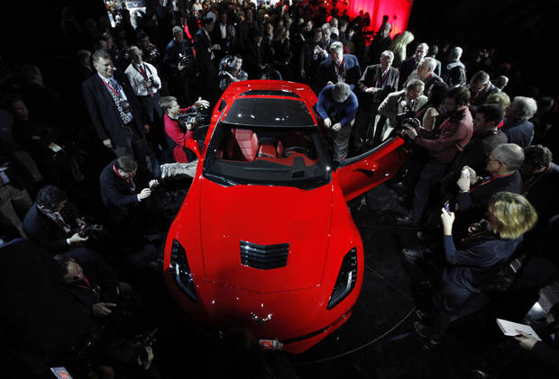Journalists surround General Motors new 2014 Chevrolet Corvette Stingray on Sunday, the night before press days at the North American International Auto Show in Detroit. AP Photo <strong>Paul Sancya</strong>