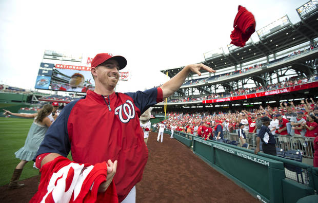 Washington Nationals' Adam LaRoche tosses Nationals shirt souvenirs to fans after the Nationals defeated the Philadelphia Phillies 5-1 in a baseball game Wednesday, Oct. 3, 2012, in Washington. (AP Photo/Manuel Balce Ceneta)