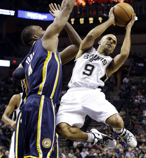 San Antonio Spurs' Tony Parker (9), of France, looks to pass as Indiana Pacers' Sam Young, left, defends during the third quarter of an NBA basketball game, Monday, Nov. 5, 2012, in San Antonio. (AP Photo/Eric Gay)