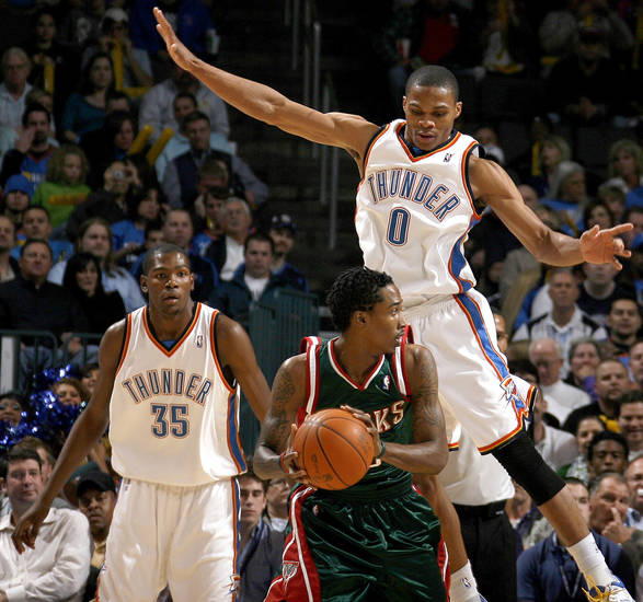 Oklahoma City's Russell Westbrook defends Milwaukee's Brandon Jennings as Kevin Durant watches during the NBA basketball game between the Oklahoma City Thunder and the Milwaukee Bucks at the Ford Center in Oklahoma City on Friday, November 27, 2009. Photo by Bryan Terry, The Oklahoman ORG XMIT: KOD
