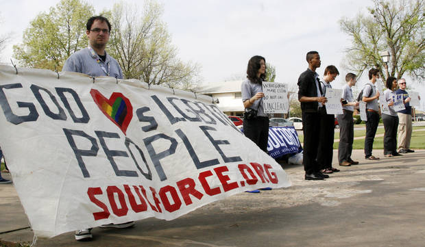 Eric Karabetsos holds a banner with others during the Equality Ride hosted by Soulforce on the campus of Oklahoma Baptist University in Shawnee Wednesday March 28, 2012. Photo by Silas Allen, The Oklahoman