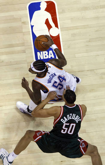Chris Wilcox (54), of the Thunder, looks to drive against the Bucks' Dan Gadzuric (50) during the first half of the opening night NBA basketball game between the Oklahoma City Thunder and the Milwaukee Bucks on Wednesday, Oct. 29, 2008, at the Ford Center in Oklahoma City, Okla.