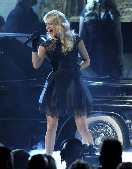 "Carrie Underwood performs ""Two Black Cadillacs"" at the 48th Annual Academy of Country Music Awards at the MGM Grand Garden Arena in Las Vegas on Sunday, April 7, 2013. (Photo by Chris Pizzello/Invision/AP) ORG XMIT: NVPM255"