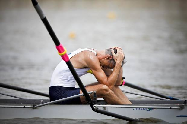 A member of the Malta Boat Club team hangs his head after breaking an oar in the Men's Lightweight C 2x race final during the USRowing Masters National Championships on the Oklahoma River on Saturday, Aug. 13, 2011. Photo by Zach Gray, The Oklahoman ORG XMIT: KOD