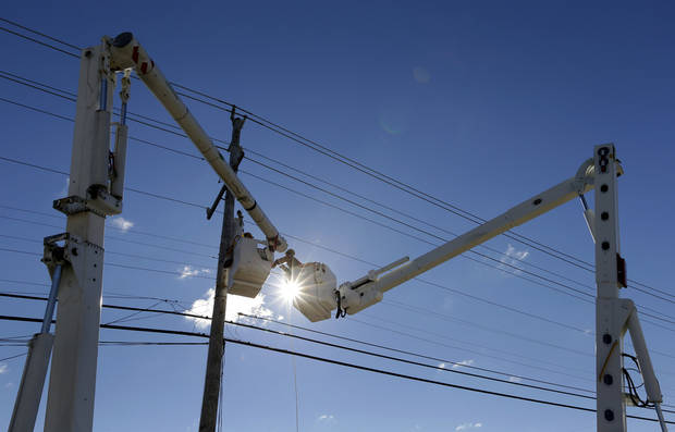 A utility crew works to restore power on Long Beach Island, N.J., Saturday, Nov. 3, 2012, after communities on the island sustained damage from Superstorm Sandy. Frustration is setting in for some New Jersey residents who are still without power and running low on food. Some residents say too much attention is being paid to the Shore and not enough to working people who are hurting. (AP Photo/Patrick Semansky)