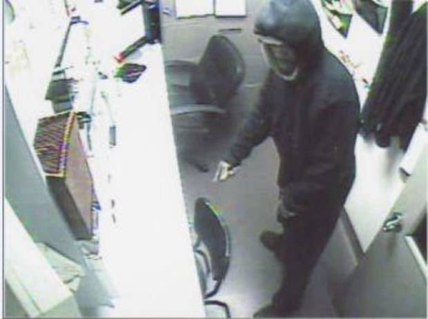 Edmond police need help in identifying the man in this picture taken from a secuirty video during a Dec. 23 armed robbery at Jason�s Deli.  PHOTO PROVIDED BY EDMOND POLICE DEPARTMENT