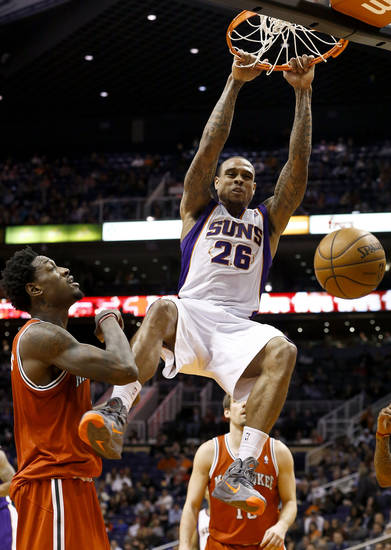Phoenix Suns' Shannon Brown (26) dunks in front of Milwaukee Bucks' Larry Sanders, left, in the second half during an NBA basketball game on Thursday, Jan. 17, 2013, in Phoenix. The Bucks defeated the Suns 98-94. (AP Photo/Ross D. Franklin)
