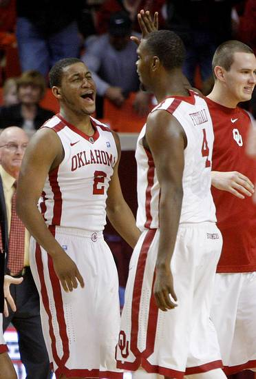 Oklahoma's Steven Pledger (2) and Andrew Fitzgerald (4) celebrate during the Bedlam men's college basketball game between the University of Oklahoma Sooners and the Oklahoma State Cowboys in Norman, Okla., Wednesday, Feb. 22, 2012. Oklahoma won 77-64. Photo by Bryan Terry, The Oklahoman