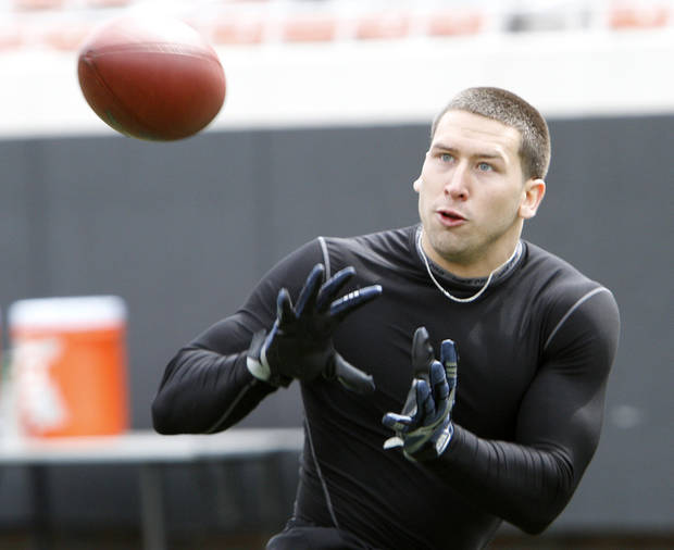 Bo Bowling catches a pass while running routes for scouts during the NFL pro day at Oklahoma State University on Wednesday, March 9, 2011, in Stillwater, Okla.  Photo by Chris Landsberger, The Oklahoman
