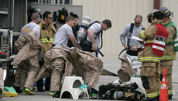 Firefighters prepare to enter a mock  emergency drill  of the fake chemical explosion during training Thursday, April 5, 2007 at the Cleveland County Fairgrounds in Norman, OK. BY JACONNA AGUIRRE/THE OKLAHOMAN