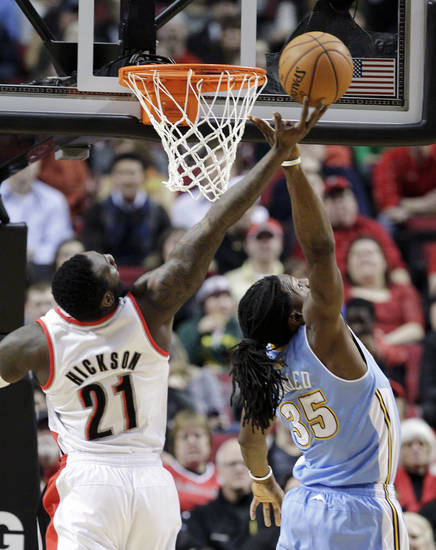Portland Trail Blazers center J.J. Hickson (21) and Denver Nuggets forward Kenneth Faried battle for a rebound during the first quarter of an NBA basketball game in Portland, Ore., Wednesday, Feb. 27, 2013. (AP Photo/Don Ryan)