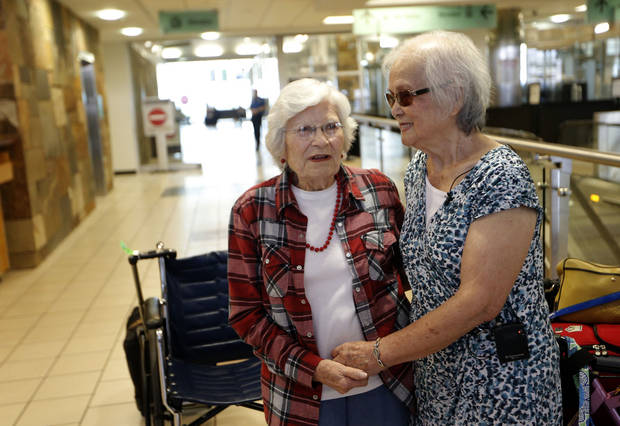 Sadie Fanali,left, and Lorraine Thomas meet for the first time at Will Roger World Airport, Friday, June 14, 2013, in Oklahoma City.  The pair have been pen pals since 1932. Photo by Sarah Phipps, The Oklahoman