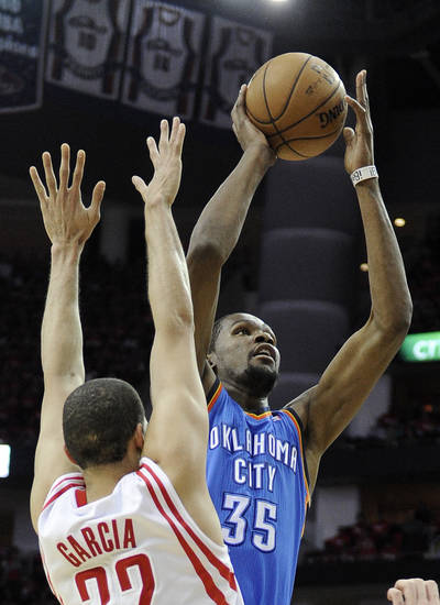 Oklahoma City Thunder's Kevin Durant (35) shoots in front of Houston Rockets' Francisco Garcia (32) in the first quarter of Game 6 in a first-round NBA basketball playoff series Friday, May 3, 2013, in Houston. (AP Photo/Pat Sullivan)