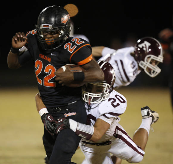 Ada's Mason Girdley (20) takes down Douglass's Christopher High (22) during a high school football game between Douglass and Ada at Moses F. Miller Stadium in Oklahoma City, Friday, Nov. 2, 2012.  Photo by Garett Fisbeck, The Oklahoman