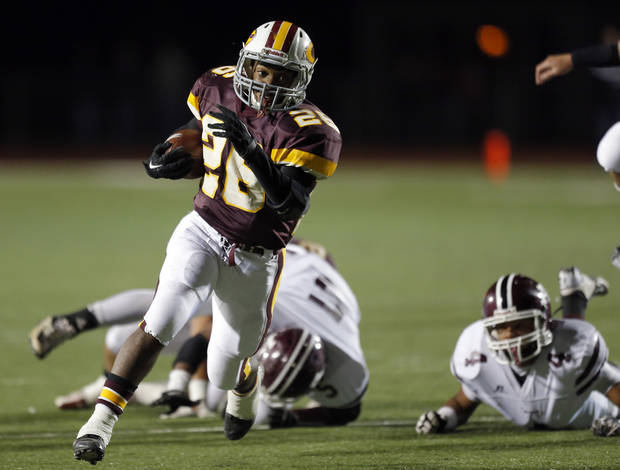 Clinton's Jevin Jefferson rushes during the high school playoff game between Ada and Clinton at Putnam City High School in Oklahoma City, Friday, Nov. 23, 2012. Photo by Sarah Phipps, The Oklahoman