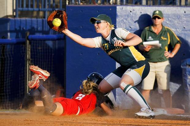 U.S. / UNITED STATES / TEAM USA / USA SOFTBALL TEAM: The USA's Kelly Grieve (2) slides into first after attempting to steal during the World Cup of Softball at ASA Hall of Fame Stadium in Oklahoma City on Friday, July 22, 2011. The USA beat Australia 5-2. Photo by Zach Gray, The Oklahoman ORG XMIT: KOD