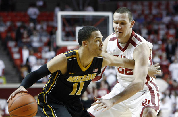 Missouri's Michael Dixon (11) goes to the basket as Oklahoma's Casey Arent (32) defends during the first half of an NCAA college basketball game in Norman, Okla. on Monday, Feb. 6, 2012.  (AP Photo/Alonzo Adams) ORG XMIT: OKAA102