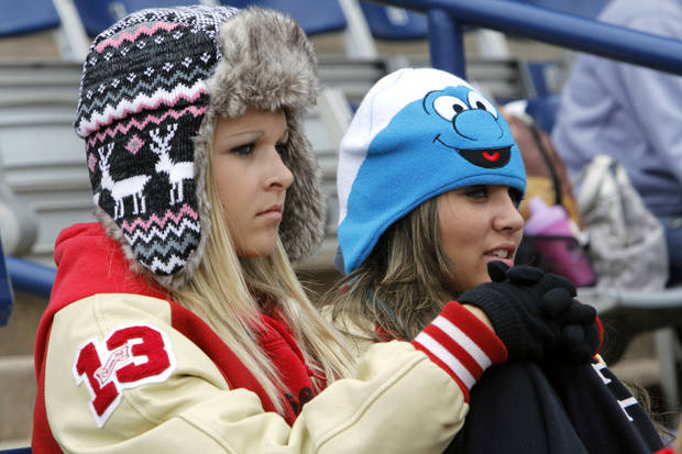 Ringwood fans Baleigh Folger, left, and Kellie Wostal bundle up while watching the Girl's State Softball playoffs at the ASA Hall of Fame Stadium in Oklahoma City, OK, Friday, October 5, 2012,  By Paul Hellstern, The Oklahoman