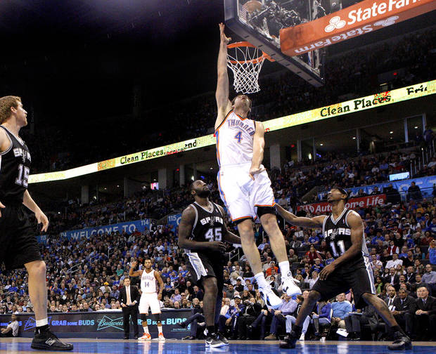 Oklahoma City Thunder's Nick Collison (4) dunks as San Antonio Spurs' Matt Bonner (15), DeJuan Blair (45) and T.J. Ford (11) defend during the the NBA basketball game between the Oklahoma City Thunder and the San Antonio Spurs at the Chesapeake Energy Arena in Oklahoma City, Sunday, Jan. 8, 2012. Photo by Sarah Phipps, The Oklahoman