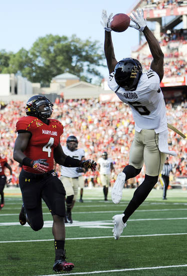 Wake Forest cornerback Chibuikem Okoro (6) breaks up a pass intended for Maryland running back Wes Brown (4) during the first half of an NCAA football game, Saturday, Oct. 6, 2012, in College Park, Md. (AP Photo/Nick Wass)